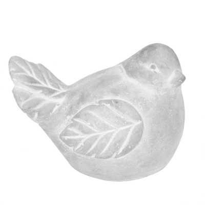Oiseau assis en ciment